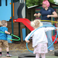 developing coordination and gross motor skills with hula-hoops